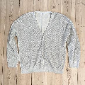 Cotton short cardigan (hip length) with mesh like knitting in front and at arms. Solid in back. Cotton. Perfect for all occasions.