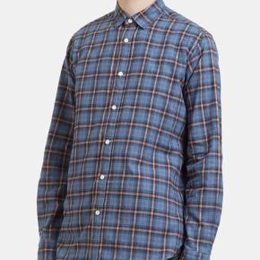 Saint Laurent Paris flannel in size 38 fits like a size S. Very good condition.  Retail was 500eur have the receipt and tags.