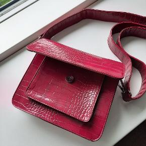 Worn once, almost perfect condition. No flaws or marks. The color is raspberry red.