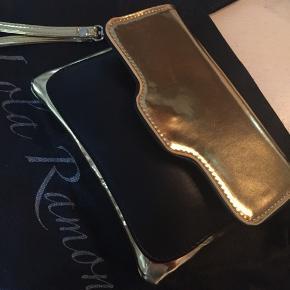 Fin lille clutch fra Lola Ramona i sort og guld. Aldrig brugt