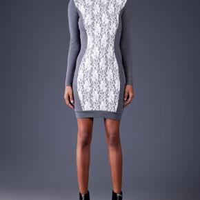 Very flattering cut,  figure enhancing embroidery in white lace .  Never worn , byMaleneBirger  , 1900 dkk pricetag