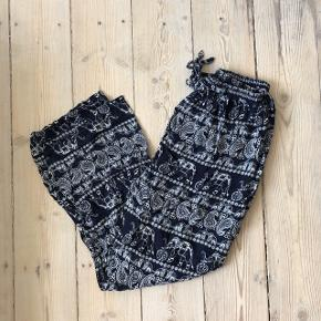 Elephant pants, super comfortable but not in the best condition. Has a hole at the crotch area but can be easily fixed - hence the very low price!