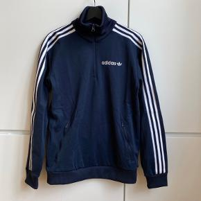 Adidas originals oversized nay tracksuit jumper. Zipped collar and pockets. Size S. Very good condition, work few times only.