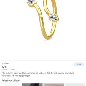 Fin ring fra Spinning i guld med sten i hver ende. Passer alle størrelser, da den justeres i størrelsen  Kan sendes med DAO