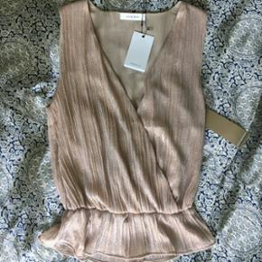 Sleevless blouse in Rose Gold tones by ANINE BING. New with all tags.