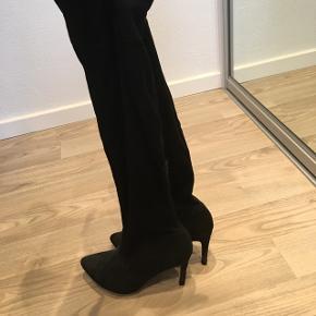 Smukke langskaftet støvler, har lige fået nye hæle dutter