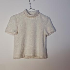 Fluffy white t-shirt with pearl details