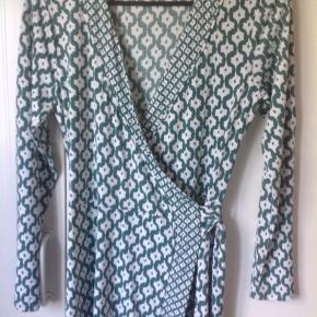 Feminine wrap dress. Used only once. It's a beautiful dark mint color.