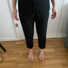 A very nice basic pantsuit from Sandro Paris. I haven't used them much as I don't find them flattering for my body type and they are a bit too big.