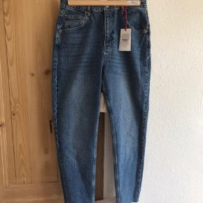 tried on, never worn, new with tags. called 'edie' -super high waist, super slim leg. size 30w, 30l