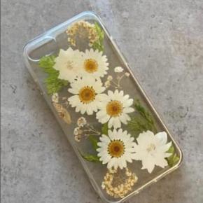 Rigtig flot cover, købt i Australien. Med ægte tørrede blomster Kan bruges til en iPhone 8