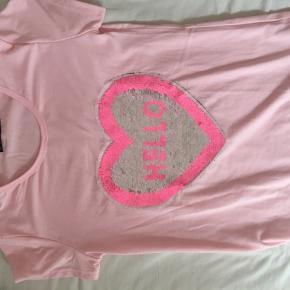 Sælger en T-shirt fra happy Star med palietter, 12 år. Np: 200kr. Næsten som ny