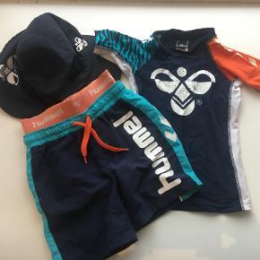 Lækker sæt fra Hummel - Shorts, Bluse - Solhat med skygge(fåes med i prisen) Ser nyt ud, på nær den orange farve på shortsene - den dækkes dog af blusen..