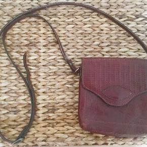Italian leather small crossbody bag.