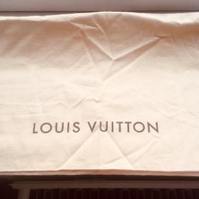 LV original dust bag. 😊