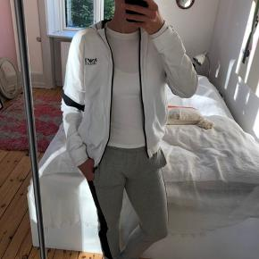 Armani Junior sweatsuit White // Grey // Black  Hoodie and pants size 16 years old (I'm normally a size s)  Very comfortable suit. Pants has nice pockets and the same on the hoodie.  Ask for more info/pictures