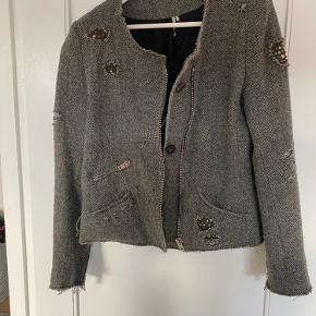 Fedt jakke lavet af uld og bomuld