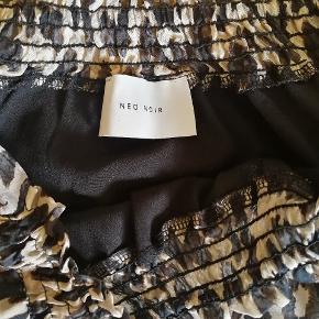 Leopard print nederdel.