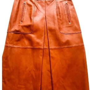 Beautifully cut tan leather midi skirt. It's Zara from a few seasons ago but exactly like Aa Prada skirt this season! Never worn. Perfect condition. No trades or swaps.