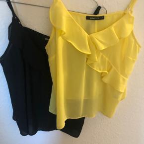 To fine toppe i gul og sort. Næsten som ny.   Prisen er pr stk  Skriv for flere billeder eller andet:)