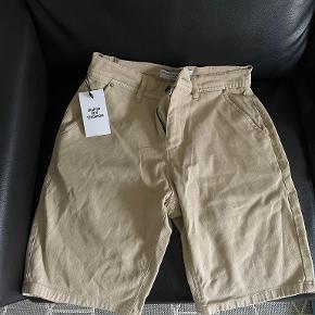 Shaping New Tomorrow shorts