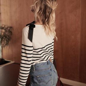 Classic stripped black thick shirt with a cute bow by Sezane.  It's a cross between a shirt and a sweater.