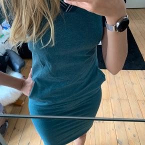 Sporty dress 👗 never worn. Has pockets.