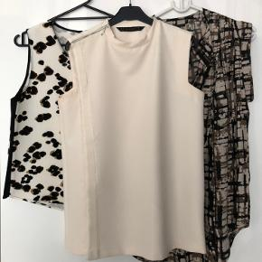 Zara Leo top in size medium, used once.  Zara top with zip in size small, worn once too. Full circle top in size xs, oversized. Never worn. Price for all 3.