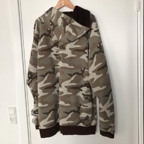 Reversible hooded jacket.