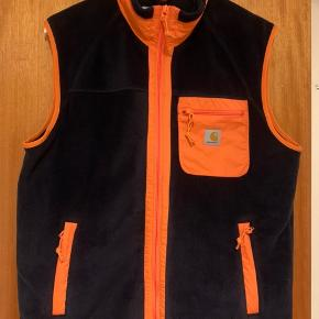 Carhartt WIP Prentis Vest Liner.  Farve: Dark navy, orange.  Asia exclusive, kun blivet solgt i udvalgte Carhartt WIP Stores.  As good as new.
