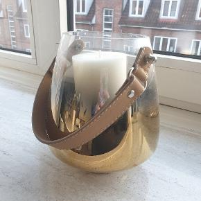 Nice vase/candle holder, has been used a bit but there is no permanent stains or such.