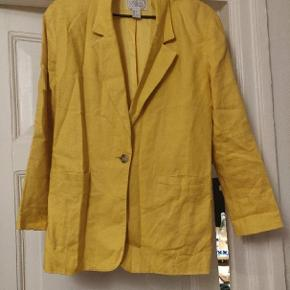 Vintage linen jacket. Needs ironing but otherwise is in good condition.