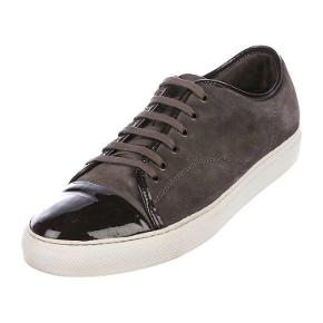 Dark gray/charcoal classic Lanvin patent shoe cap sneaker. Retail price is 2700dkk.  Size is a UK 7 equal to a EU 41. Run a little bit big in size.  Bought from The RealReal and have the receipt. The pictures are of my actual shoes taken by realreal.com but happy to send more pics.