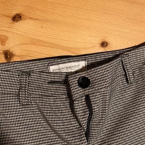"A fancy short-leg trouser. Size S, used 1 or 2 times. Made in Italy, brand ""rinasciemento""."
