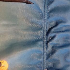 Ninjago badebukser str. 110/116. Der er lidt fnuller på dem, som kan ses på billede 2.