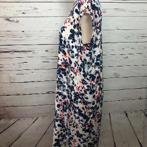 You can get lost in this water-color print. There are loops for a belt, but it can also be warn as is.  100% viscose.  Machine wash warm.