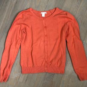 Orange cardigan kun brugt få gange