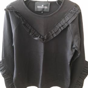 Sweater med fine blæser.