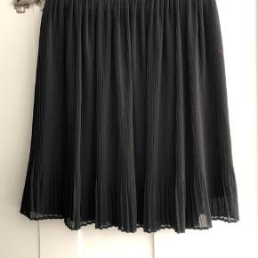 Sød plisseret nederdel