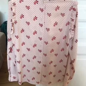 size s fits like a loose 36. called 'Joelle'. buttons all the way down the back. never worn just tried on