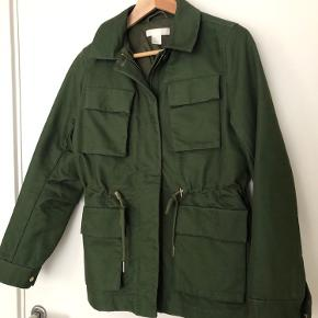 Cotton jacket in beautiful quality and great fit. Worn once. Like new.
