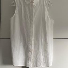 Mango skjorte uden ærmer, xs.  Aldrig brugt.  Ingen bytte. Porto kommer oveni.  #30dayssellout