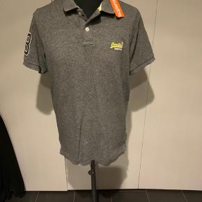 Ny herre polo t-shirt i grå str xl. Stadig med mærke.  Køber betaler Porto.
