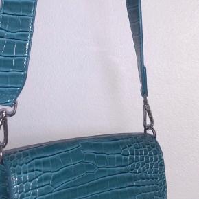 Hvisk taske i farven Petroleum/Blå