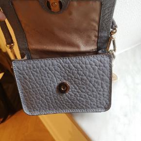 Dkny lille taske. Er aldrig brugt. Fremstår som ny