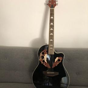 Jeg vil gerne sælge denne western OVA-5-BK guitar fra Street, da den aldrig rigtig er blevet brugt