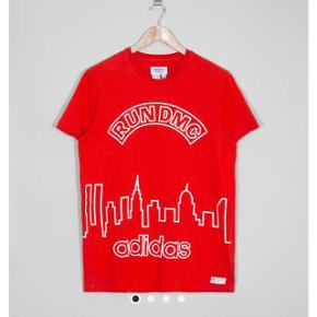First picture is from the internet, the rest is mine. The one I am selling has black text and is new - never worn! Run dmc Adidas. It is a tank top, not a t-shirt.