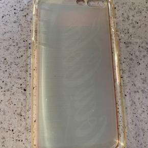Gennemsigtigt iphone 7+ plastic cover m/ Coca-Cola tryk  Brugt meget 1 gang, og i 100% pæn stand.