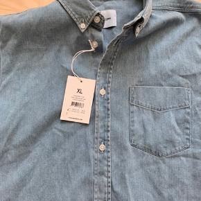 Kortærmet skjorte. Str XL. Ikke brugt.