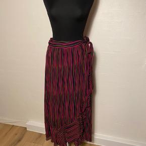 Slå om nederdel  Størrelsessvarende Flæse ned foran